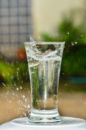 drop in: water drop in glass