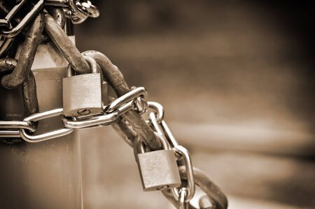 special steel: closed padlock with key in sepia light