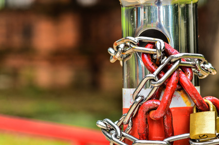 metal fastener: Two padlock with red chains