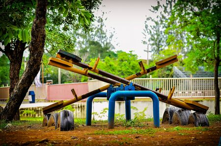Old seesaw at the playground in vintage light Stock Photo