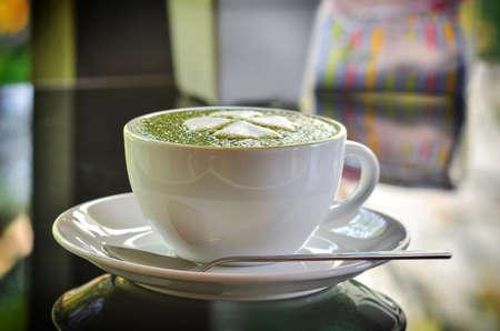 Hot green tea latte with matcha powder Stock Photo