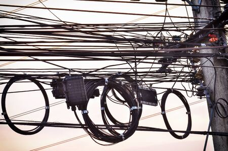 Wire electric in pole it messy Stock Photo