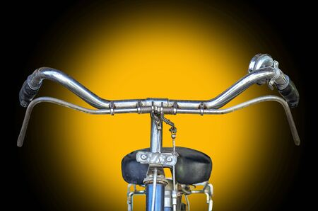 road bike: Bicycle part isolate on yellow light background