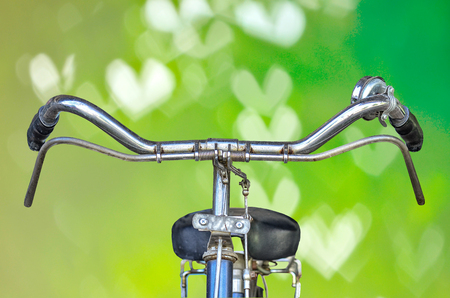road bike: Bicycle part isolate on green nature background