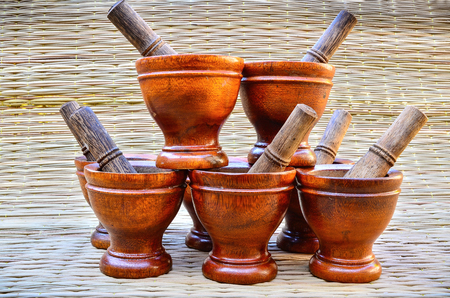 Group Wooden mortar with pestle on Reed mats