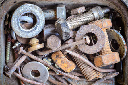 Many bolts nut nail store in containner Stock Photo