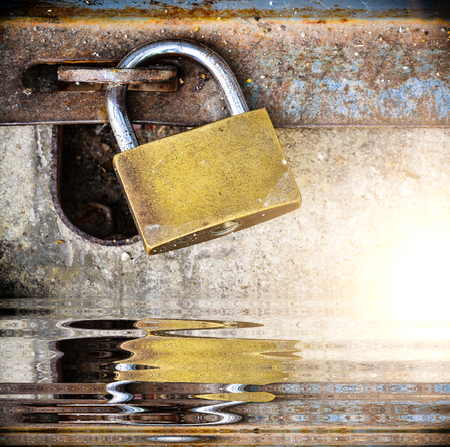 Lock door metal with golden key and reflect Stock Photo