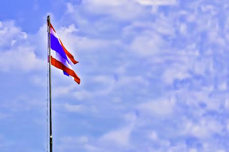Thai flag with wind on blur sky Stock Photo
