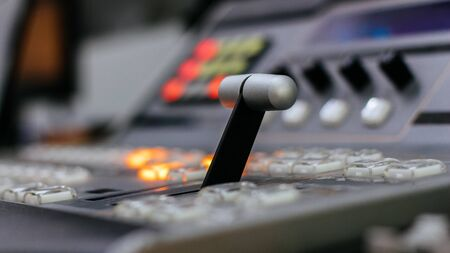 Close up of video mixer control panel at tv broadcasting studio. Selective focus.