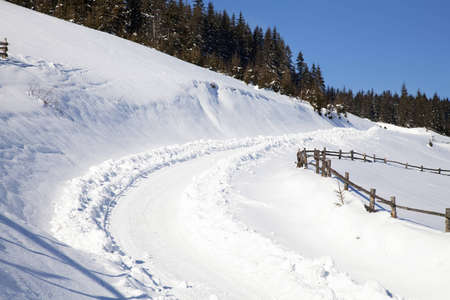 Winter road in mountains in Carpathians photo