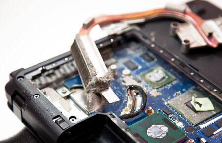 Laptop inside dirty cooling system full of dust