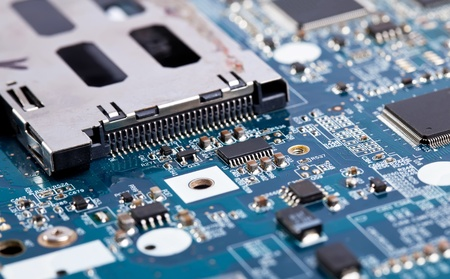 computer transistors: Laptop motherboard blue close view on details