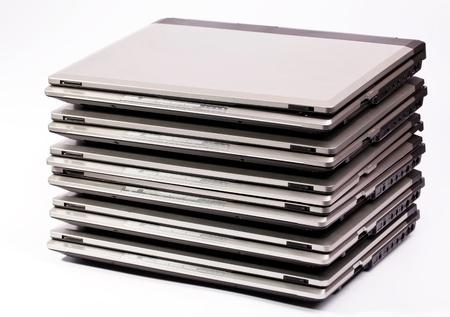 Pile of laptops on the white background Stok Fotoğraf