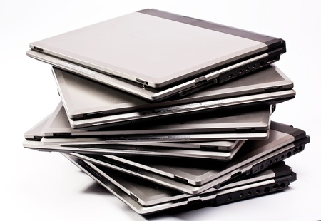 Pile of laptops on the white background photo