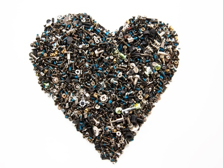 Heart shape made with hobnails and screws photo