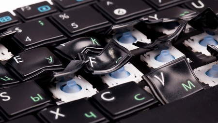 Black laptop keyboard with distorted keys on it photo