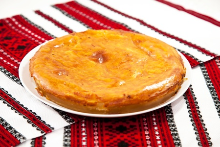 Onion and cheese pie on traditional ukrainian towel Stock Photo
