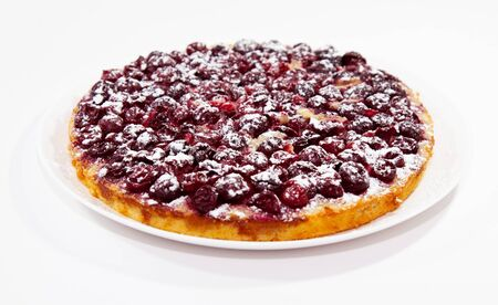 Tasty cherry pie with powdered sugar on white plate photo