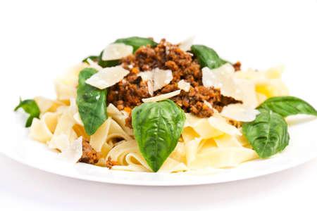 Spaghetti carbonara on white plate with basil photo