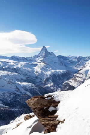 Winter swiss landscape with Matterhorm mountain and stone