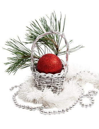 Christmas basket decoration with red ball on white background