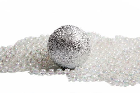 Christmas decorations with big silver ball and white beads Stock Photo