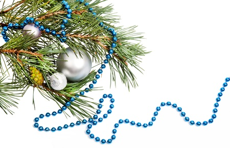 Christmas decorations with silver balls and blue beads on white background photo
