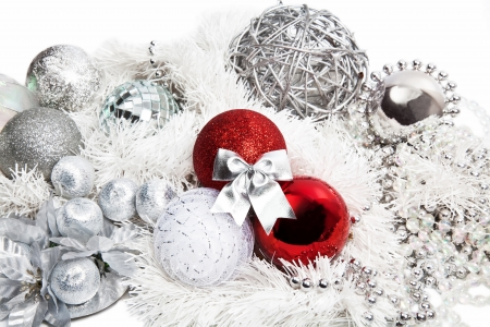 Christmas red and silver decorations on white background