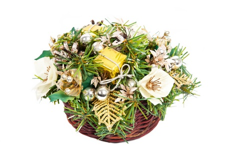 Christmas basket with golden and green decorations Stock Photo - 15311663
