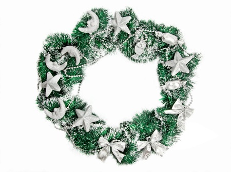 Christmas wreath with silver decorations on white background