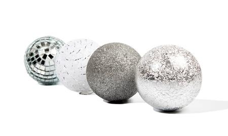 Four Christmas silver balls on white background Stock Photo - 15311667