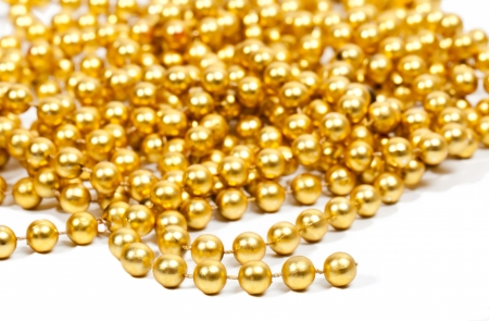 Golden beads garland on white background Stock Photo - 15311659