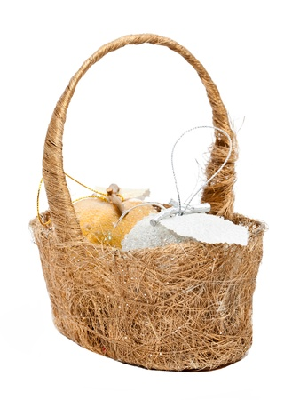 Christmas decoration basket with golden and silver apples