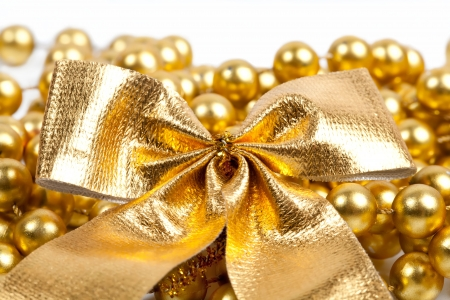 Golden Christmas bow and beads on white background Stock Photo - 15414500