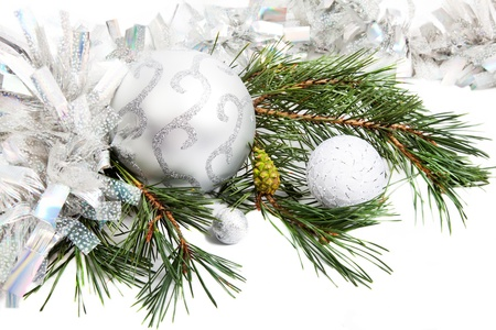 New Year composition with fir branch, tinsel and balls photo