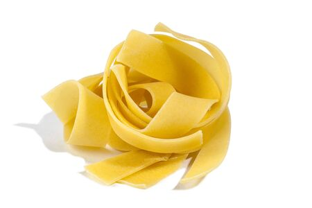 Raw pasta tagliatelle isolated on white background
