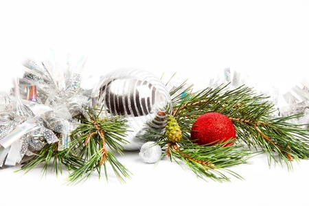 Christmas holiday composition with balls and fir branch isolated on white