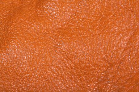 Orange leather texture background close view photo