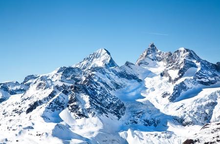 Alpine hills in snow in February Stok Fotoğraf