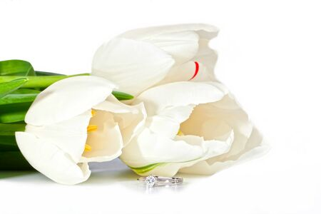 Beautiful white spring tulips with diamond ring