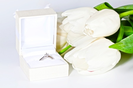 White spring tulips with box with diamond ring photo