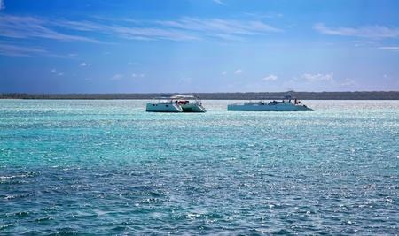 Beautiful ocean with blue sky and catamarans photo