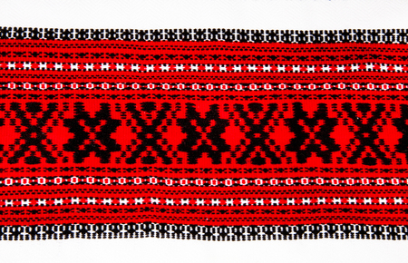 Ukrainian national red and black ornament embroidery closeup Stock Photo