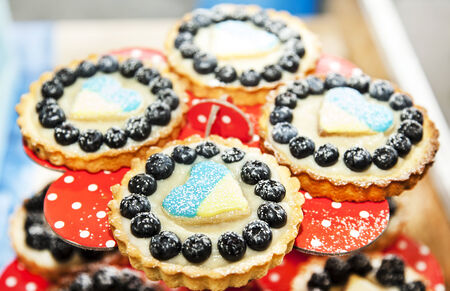 Cookie with berries and heart with ukrainian flag