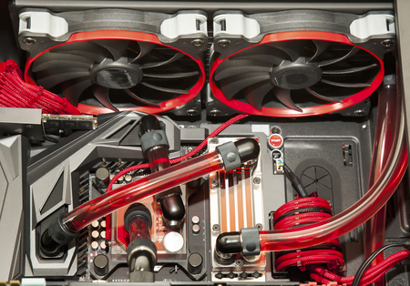 cooling system: Inside computer water cooling  system in red background