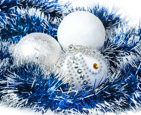 Christmas blue tinsel and white with silver glitter balls decoration Stock Photo