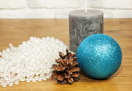 New Year 2017 composition with fir cones and candle on wooden background