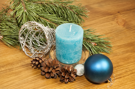 New Year 2017 composition with blue ball and candle on wooden background closeuo
