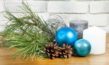 New Year 2017 composition with bright blue ball and white and grey candle Stock Photo