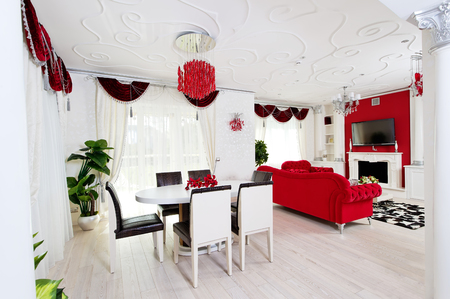 Classical living room interior in white and red colors